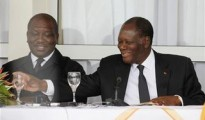 "Ivory Coast""s President Alassane Ouattara (R) smiles next to Interior Minister Hamed Bakayoko during a news conference in Man, in the west of Ivory Coast"