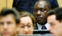 Congolese warlord Thomas Lubanga Dyilo sits in the ICC courtroom in the Hague.