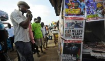 People read newspapers reporting the death of Ghana's President John Atta Mills on Tuesday, in the capital Accra. Ghana has seen a smooth transition of power after the sudden death of its president, but as the nation mourns attention is already turning to who will replace him as the ruling party's candidate in a December vote.
