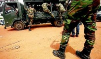 RAID: Soldiers patrol near the Akouedo camp after an attack in Abidjan on Monday. A group of unidentified, heavily armed men in civilian clothes stormed the army camp