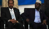 Somalia's newly elected President Hassan Sheikh Mohamud and his predecessor Sharif Sheikh Ahmed (R) listen to proceedings after winning the election, in Mogadishu September 10, 2012.