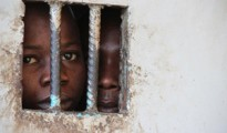 Juveniles in a police cell in a Sierra Leone, where women are being detained for owing debt .(Photo: Otto Bakano/IRIN)