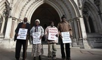 Wambugu Nyingi, Jane Muthoni, Paul Nzili and Ndiku Mutua (L-R) stand outside the High Court in London April 7, 2011