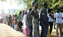 A photo showing Gambians wait to vote outside a polling station in Serrekunda, southwest the capital Banjul, during the presidential elections in 2011