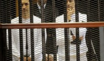 Alaa (left) and Gamal Mubarak inside a cell during their corruption trial in August 2011. The two sons of ousted Egyptian president Hosni Mubarak held $340 million in now frozen assets in Swiss bank accounts .