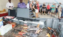 Weapons seized by the Nigerian Navy from Russian ship, Merchant Vessel Myre Sea Diver, Avatie, during the handing over of the arrested members of the 15-man Russian crew to the Nigeria Police at the Western Naval Command in Lagos...on Monday. (Inset) Cross-section of the crew members. | credits: Eniola Akinkuotu