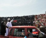 President Koroma of Sierra Leone waves to thousands of supporters during his inauguration in February 2013 .