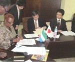 Photo:-L-R (Acting Minister of Foreign Affairs and International Cooperation Dr. Ebun A. Jusu signing the agreement with the Japanese Ambassador to Sierra Leone Mr. Naoto Nikai)