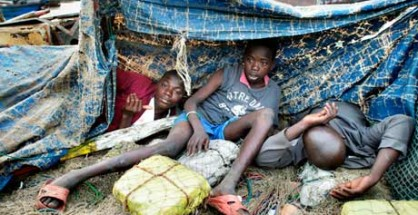 Street children in their makeshift homes of plastic sheeting in the port of Conakry, Guinea. Photograph: Alamy