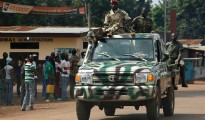 Seleka presidential guard soldiers drive on pickups in Miskine district in Bangui.