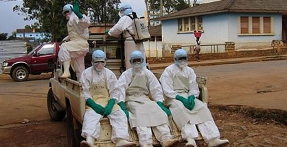 "Curbing the outbreak ... health workers, dressed in head-to-toe ""Ebola suits"", leave Uige, about 300km north of the Angolan capital, Luanda, to collect a man dying from haemorrhagic fever in 2005. (file photo)"