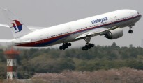 This photo taken in April, 2013, shows a Malaysia Airlines Boeing 777-200ER at Narita Airport in Narita, near Tokyo. A Malaysia Airlines Boeing 777-200 carrying 239 people lost contact with air traffic control early Saturday morning, March 8, 2014 on a flight from Kuala Lumpur to Beijing, and international aviation authorities still hadn't located the jetliner (file photo)