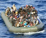A boat with African migrants spotted by the Navy at sea near Lampedusa, Italy, in February this year, where hundreds of thousands are set to follow this summer . (2014)