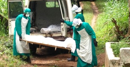 Health workers carry an Ebola virus victim in Kenema, Sierra Leone