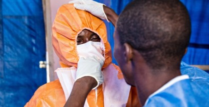Healthcare workers wear protective gear before entering into an Ebola treatment centre in Freetown, Sierra Leone