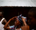 Adamsay Fofanah (center) lives in the village of Royail, which has been hit hard by the Ebola outbreak. Her mother died the day before, most likely of the virus.