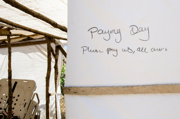 "Graffiti on one of the structures in the Ebola isolation area at Kenema Government Hospital: ""Pay my Day; Please pay us, all ours""Amy Maxmen"